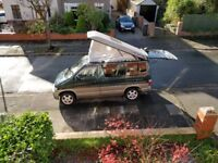 Unconverted Mazda bongo with pop-top tent roof
