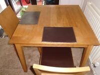 SQUARE OAK DINING TABLE & 2 CHAIRS FOR SALE.