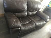 Reclining brown leather sofa