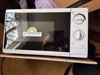 700w Tesco MM08 microwave INCOMPLETE glass turntable missing.