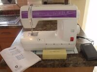 Toyota electronic RS2000 sewing machine, with foot pedal & instructions