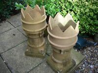 A pair of crown chimney pots