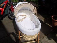 Baby Mosses basket and pine rocker.