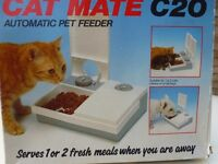 Automatic pet feeder. Serves 1 or 2 fresh meals for your cat, dog etc while you're away.