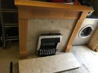 Wooden surround, stone resin marble effect mantle and hearth and electric fire