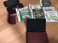 Nintendo DS XL console with accessories and games
