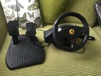 Gamer steering wheel and pedals.