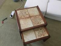 set of 2 nest of tables , top tiled , mahogany wooden frame