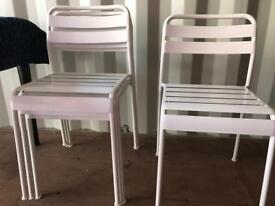 Four metal chairs white