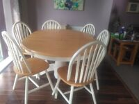 Extendable dinging table and chairs. Pine with cream paint.