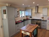 Fitted kitchen units including base cupboards, wall cupboards and granite work top.