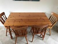 Solid wood table and chairs.