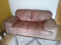 Two seater brown leather sofas x2