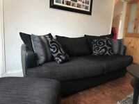 Black DFS half leather three piece sofa with footstool