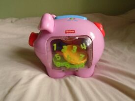 FISHER PRICE MUSICAL PIGGY BANK TOY