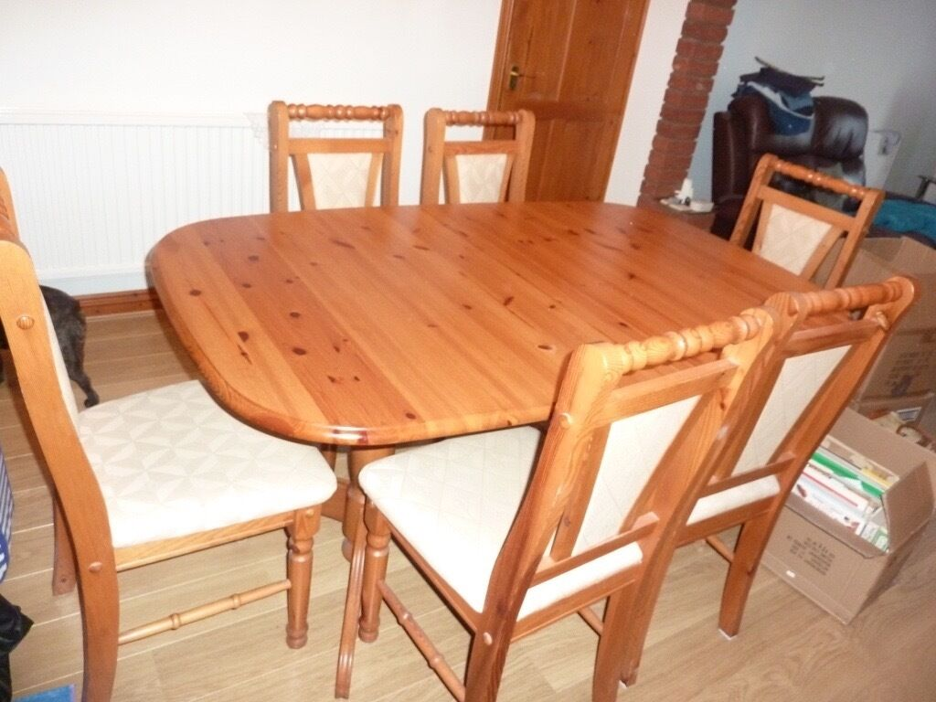 Pine table and six chairs extends to seat 8