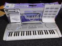 Electronic keyboard, and *Teach yourself book and chord charts*, as new.