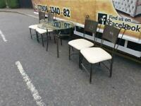 Glass top table and chairs £85