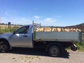 Barn stored seasoned hardwood firewood logs for sale