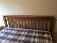 2 x identical wooden double bed frames and mattresses