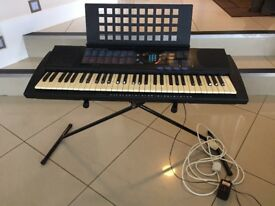 Yamaha Electric Keyboard/Piano with stand. All in good condition