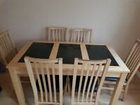 Dining table and 6 chairs - solid with black granite panels