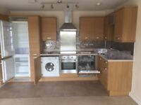 Symphony wood effect fitted kitchen with Zanussi intergrated appliances.