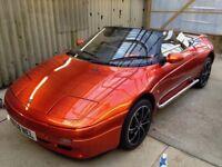 Lotus M100 in Volcano Orange