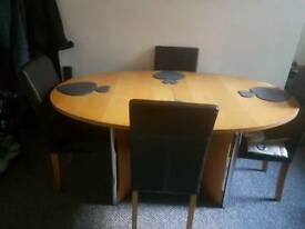 Table and 4 Chairs £60