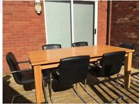 Solid oak dining table and 8 leather chairs