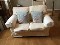 Two seater cream sofa