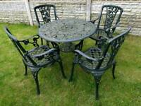 Cast iron bistro table and 4 chairs parasol base