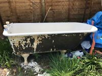 Vintage cast iron bath with roll top