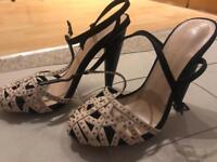 Brand new heels size 4