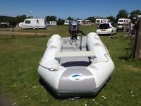 Inflatable dinghy outboard and launching trolley