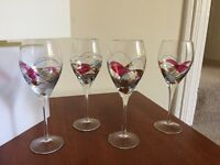 4 decorated long stem wine glasses and 2 brandy glasses
