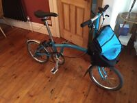 nearly new brompton bike with bag, bought January