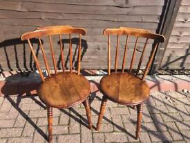 A Pair of antique Ibex Style kitchen chairs