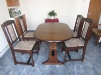 Extending oak table and four chairs