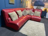 Red leather Italian corner sofa. The suite has back support cushions