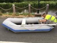 Inflatable boat dinghy tender and engine