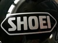 Black SHOEI motorcycle helmet