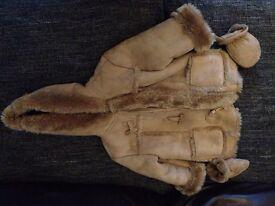 BNWOT boys/girls cuddly coat 9-12 mths (fits 1-2yrs)