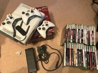 Xbox 360 plus 33 games, 3 wireless controllers and wifi pack
