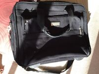 Compusafe Laptop/ overnight bag with wheels/ handle and detachable carry straps