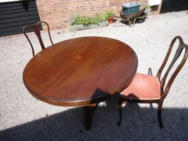 ANTIQUE WOODEN PEDESTAL DINING TABLE AND TWO CHAIRS