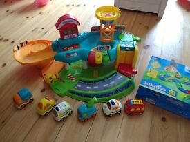 Vtech toot toot garage, 6 vehicles and brand new in box road track set includes police, fire engine