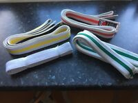 4 judo belts: white, yellow, green and red