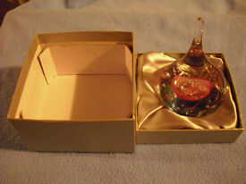 Beautiful coloured and unusual shaped paperweight boxed.