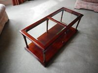Coffee Table - glass topped dark wood coffee table with shelf for magazines